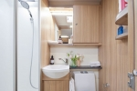 6143aaa97cfd3pegasus-grande-se-ancona-washroom-featuring-white-gloss-shower-cubicle-with-bi-fold-partition-door-768x512.jpg